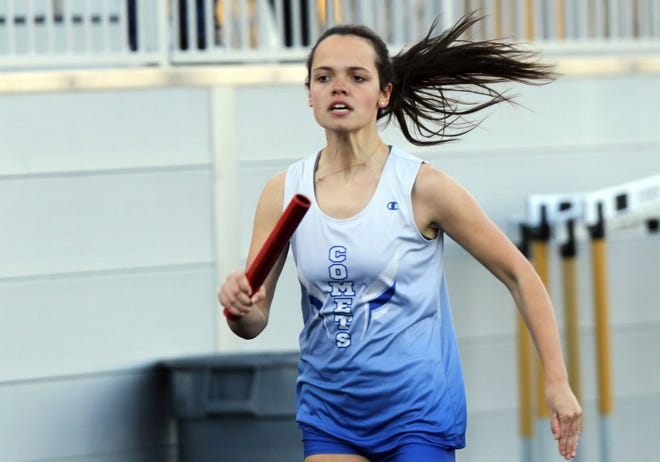 """The Comets' Brynn Dickman runs her leg of the 800-meter relay April 2 at Upper Arlington. The sophomore is expected to be the """"workhorse"""" of the team's sprinters, according to coach Reggie Cannon."""