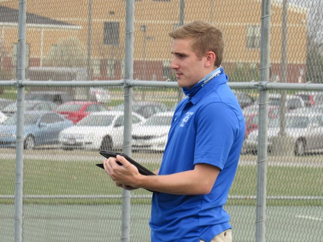 Coach Cody Hawkins speaks with the members of his Central Crossing boys tennis team during practice April 5. The Comets started with six players and are looking for at least one more player to complete the varsity lineup.