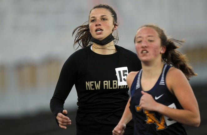 New Albany senior Alexis Curren competes in the 1,600 meters during the Upper Arlington Invitational on April 2. Curren is one of the top contributors to the Eagles' deep distance corps.