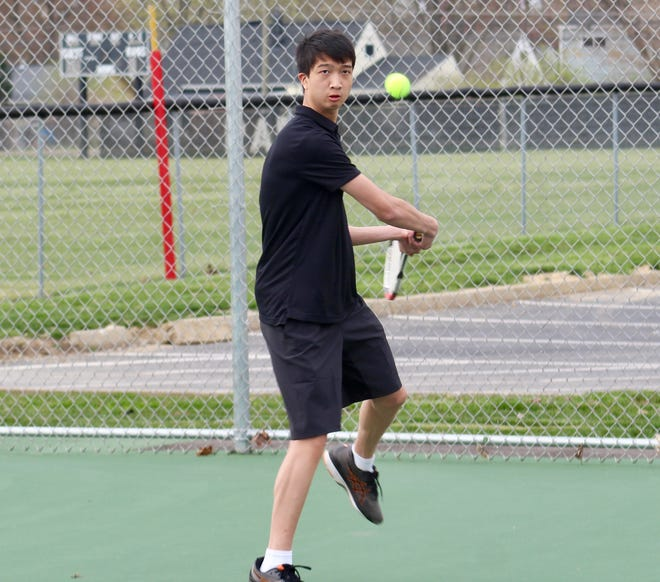 Whitehall-Yearling's Raymond Zhen prepares to return a shot during a 5-0 loss to Watkins Memorial on April 5 at home. The senior is playing first singles for the Rams.