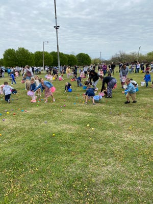 Children young and old flocked to the old Panther football stadium on April 3 for an old-fashioned Easter hunt. Hosted by Van Alstyne merchants, the event had more than 10,000 eggs filled with candy and prizes. There were separate hunts for four different age groups. Special prizes were given to those who found special eggs.  Other prizes were awarded as well, and the Easter Bunny himself made an appearance. Also in attendance were Mayor Jim Atchison and members of the Van Alstyne Police Department.