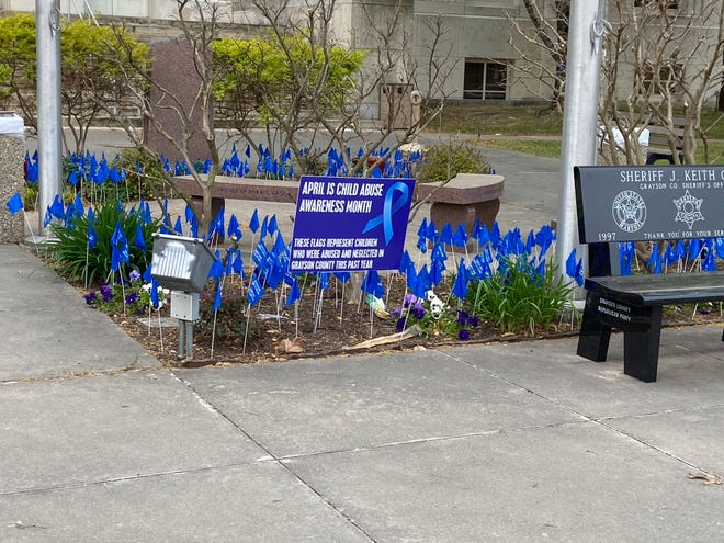 Flags placed outside of the Grayson County Courthouse mark the month as Child Abuse Prevention and Awareness Month.