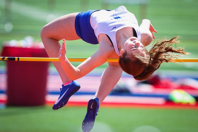 """District Champion, Samantha Moore broke a personal record in clearing 5'2"""" in the high jump."""