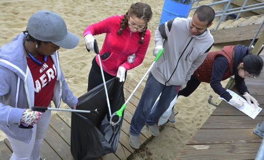 Volunteers clean a beach in Asbury Park in 2017.