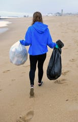 A volunteer cleans a beach in Asbury Park in 2017.