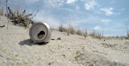A can is shown on the Sandy Hook beach in 2015, near where Clean Ocean Action and volunteers were cleaning the beach.