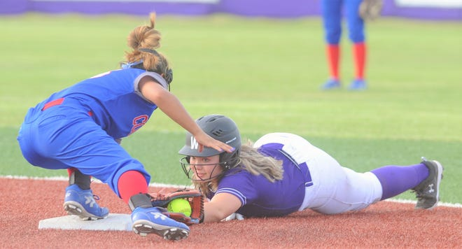 Cooper shortstop Angelic Gonzalez, left, tags out Wylie's Jadyn Fernandez after Fernandez's hand came off the bag at second base following her two-run hit in the fifth inning in the District 4-5A game April 6 at Wylie.