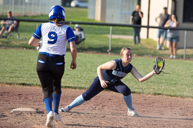 Adena's Caelan Miner catches the ball at second and attempts to tag out Chillicothe's Caroline Corcoran during a softball game at Mt. Logan in Chillicothe on April 6, 2021. Adena defeated Chillicothe 14-2.