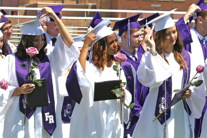 Kayla Jo Rich, Jena Laniese Reynolds, and Jordan Alexis Relford flip their tassels at Fremont Ross High School's 2019 commencement ceremony. The 2021 ceremony will be held at Don Paul Stadium, with graduating seniors allowed to bring up to four guests.