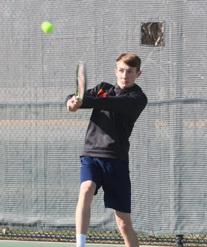 Justin Aderhold of Great Falls Central Catholic returns a backhand shot at practice Tuesday at Meadow Lark Country Club.