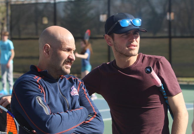 Great Falls Central head tennis coach Jason Purpura (left) and assistant Roy Munns discuss player pairings during a Tuesday practice session at Meadow Lark County Club.