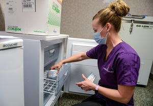 Liz Little, a nurse with the Indian Family Health Clinic, places the newest shipment of Moderna COVID-19 vaccine into the clinic freezer on Wednesday, April 7, 2021.