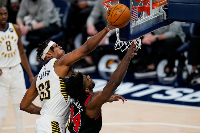 Indiana Pacers center Myles Turner (33) blocks the shot of Chicago Bulls forward Patrick Williams (44) during the second half of an NBA basketball game in Indianapolis, Tuesday, April 6, 2021. (AP Photo/Michael Conroy)