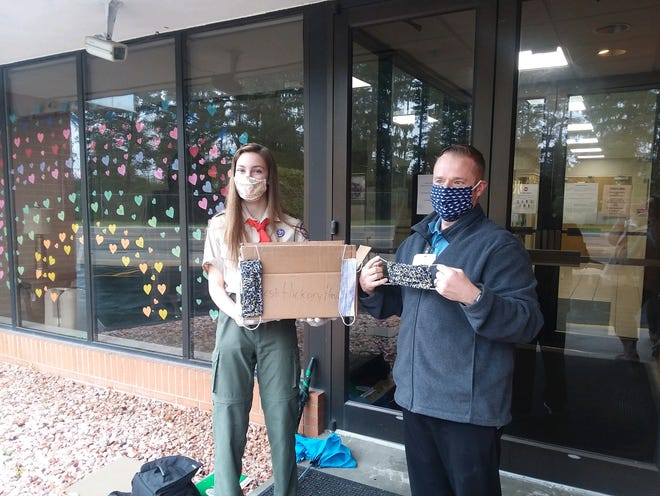 Hartland teen Jessica Witkowski drops off a box of masks to West Hickory Haven in Milford.