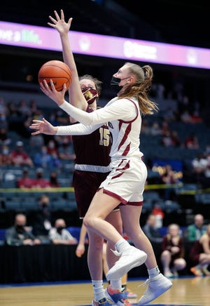 Portland's Ashley Bower, right, goes up for a layup against Parma Western's Riley Kubiak, Wednesday, April 7, 2021, at Van Andel Arena in Grand Rapids, Mich. Portland won 45-38.