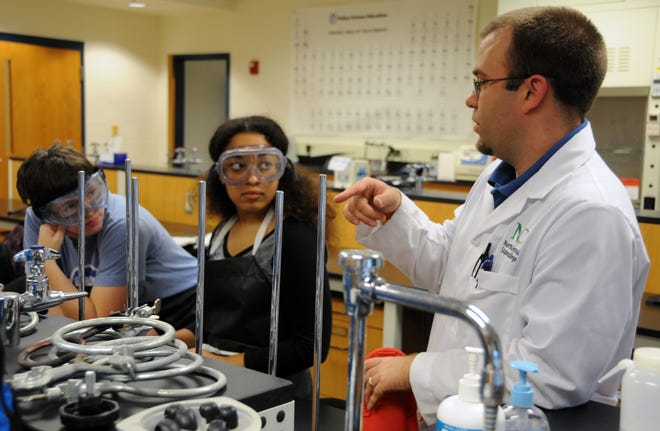 Jason Tucker, a North Central State College assistant professor of bioscience, talks to students.