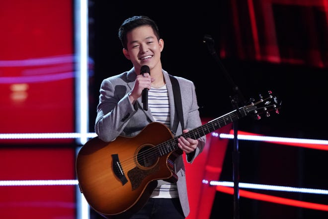 """Keegan Ferrell performs during an episode of """"The Voice,"""" which aired Monday, April 5, 2021. The musican perfomed a duet with teammate Jordan Matthew Young."""