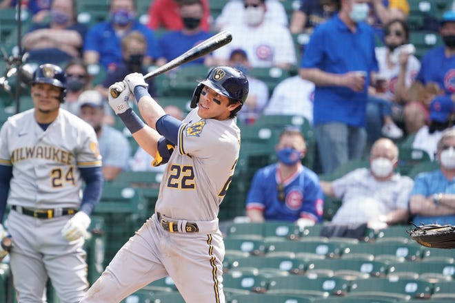 Apr 7, 2021; Chicago, Illinois, USA; Milwaukee Brewers left fielder Christian Yelich (22) hits a double against the Chicago Cubs during the fourth inning at Wrigley Field. Mandatory Credit: David Banks-USA TODAY Sports