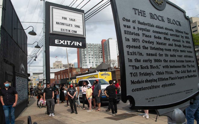A crowd gathers in front of Exit / In in Nashville, Tenn., during a rally to save the legendary music venue on Wednesday, April 7, 2021.