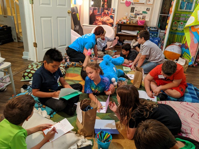 Children work on activities as part of a peer-to-peer support group for those who have lost loved ones. A new children's grief center will open in Pensacola on April 20.