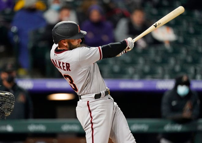 Arizona Diamondbacks' Christian Walker connects for a two-run home run off Colorado Rockies starting pitcher German Marquez in the sixth inning of a baseball game Tuesday, April 6, 2021, in Denver. (AP Photo/David Zalubowski)