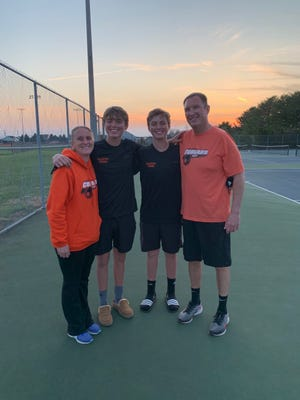 The Mahaffeys, from left, head coach Abbie, twin sons Tyler and Aidan, and Abbie's husband Keith pose for a photo following Palmyra's regular season match at Cumberland Valley.