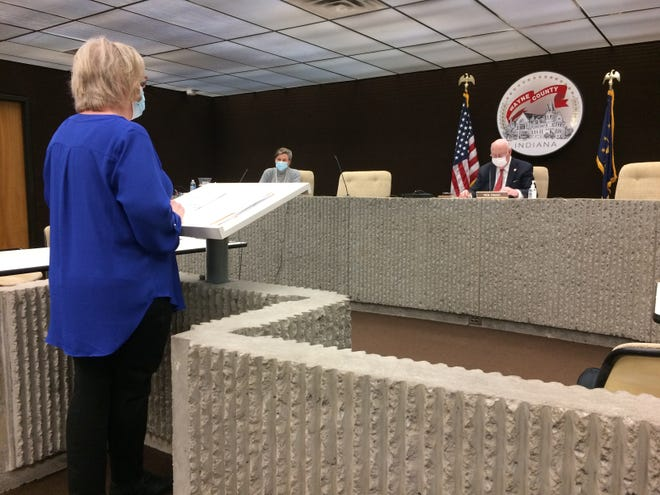 Christine Stinson, executive director of the Wayne County Health Department, speaks to Wayne County commissioners, including Mary Anne Butters and Ken Paust, on Wednesday.