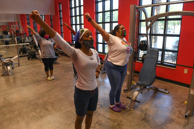 Tiasia Duncan, 16 (center) and Deonna Davis, 15, watch their reflections in a mirrored wall while practicing cheerleading with other girls inside the weight room at the Boys & Girls Club of St. Lucie County Fort Pierce Teen Center at Percy Peek Gym on Wednesday, April 7, 2021, in Fort Pierce. The Boys & Girls Club St. Lucie County chapter could benefit from a new clubhouse coming to Avenue Q at North 25th Street in a partnership between Larry Lee, the Boys & Girls Club and First Tee.