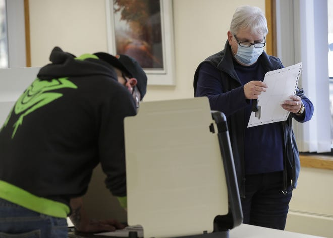 Faye Kaminski reviews her ballot before submitting it Tuesday at the District 9 polling place at the Lincoln Senior Center in Stevens Point.