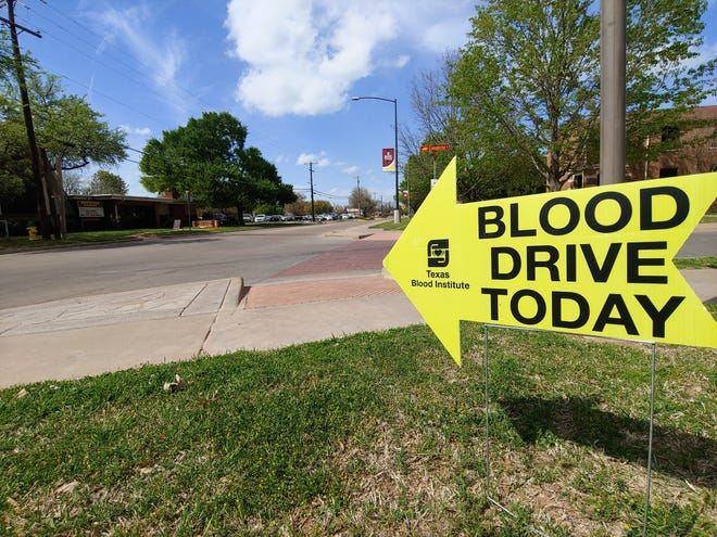 """A sign points to the Redwine Honors Program blood drive. The event is being held at the Mustangs for Christ building. Ben Schaffner, a recruitment officer for the Oklahoma Blood Institute, said, """"We were lucky to get the building this time, as our normal location wasn't available."""""""