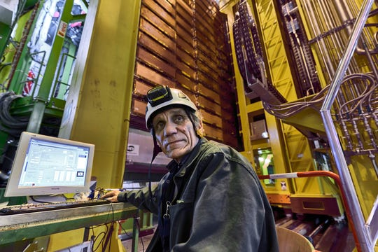 In this 2018 photo published by CERN Nikolai Bondar working on the LHCb Muon system at the European Organization for Nuclear Research Large Hadron Collider outside Geneva.  Preliminary results published in 2021 from here and the Fermilab plant in the United States challenge the way physicists think the universe works - an opportunity with the field of particle physics both puzzled and excited.