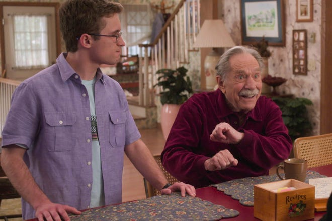 "Adam (Sean Giambrone), left, listens to his grandfather Pops (George Segal) in the April 7 episode of ABC's ""The Goldbergs."" The episode marked the final appearance of Segal, who died in March, and featured a touching video tribute to the longtime actor at the end of the show."