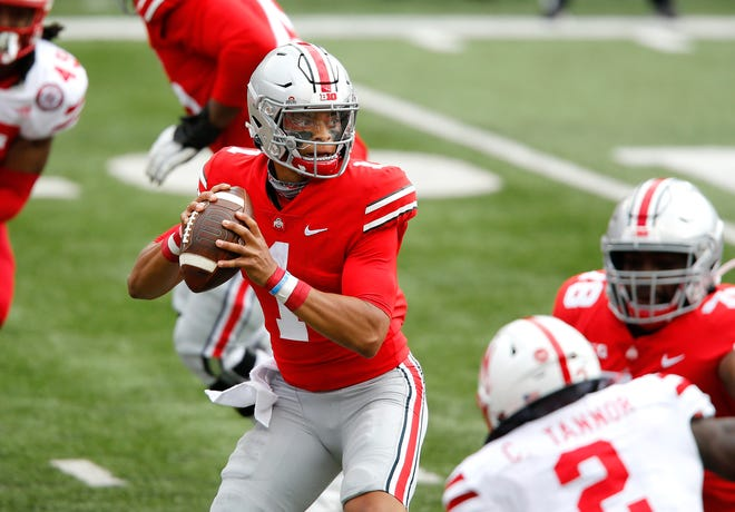 Former Ohio State Buckeyes quarterback Justin Fields drops to throw during first half against the Nebraska Cornhuskers at Ohio Stadium last season. Could the Pats be interested in drafting the QB?
