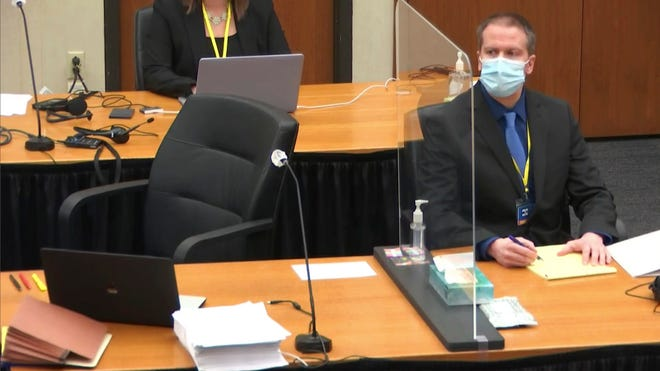 In this image taken from video, former Minneapolis police Officer Derek Chauvin watches as defense attorney Eric Nelson questions witness Los Angeles police department Sergeant Jody Stiger, Wednesday, April 7, 2021.