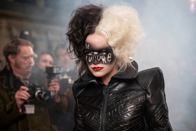 """Emma Stone plays the classic Disney villainess as a young 1970s punk fashionista in """"Cruella."""""""