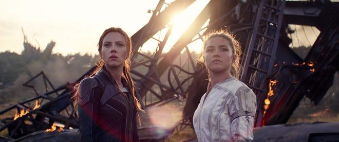 "Natasha Romanoff (Scarlett Johansson, left) reconnects with her ""little sister"" Yelena (Florence Pugh) in ""Black Widow."""