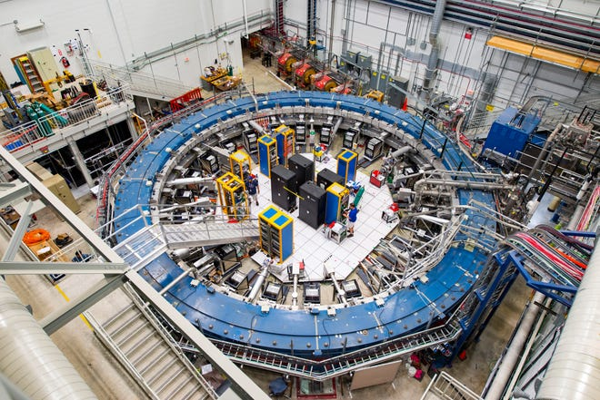 This August 2017 photo made available by Fermilab shows the Muon g-2 ring at the Fermi National Accelerator Laboratory outside of Chicago. It operates at -450 degrees Fahrenheit to detect the wobble of muons as they travel through a magnetic field. Preliminary results published in 2021 of experiments from here and the CERN facility in Europe challenge the way physicists think the universe works, a prospect that has the field of particle physics both baffled and thrilled.