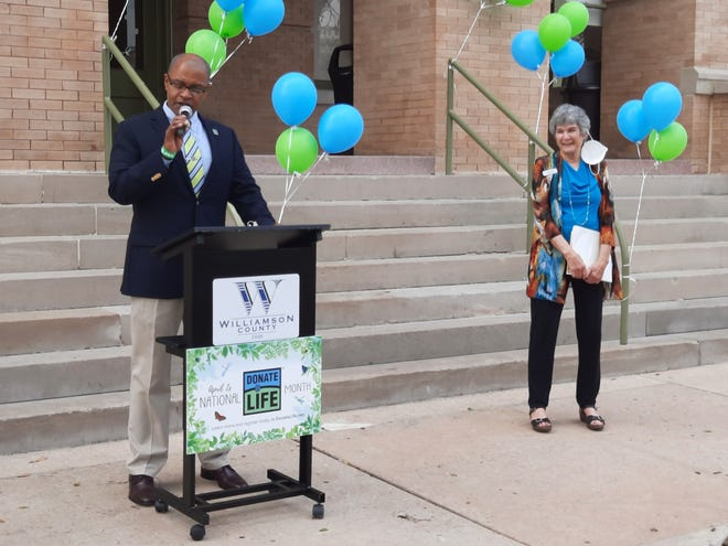 S. Lemuel Bradshaw, public relations manager for United Tissue Resources in Austin and twice the recipient of a heart transplant, introduces Commissioner Terry Cook at the National Donate Life Month news conference on April 7 at the Williamson County Courthouse in Georgetown.