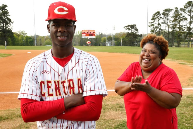 Clarke Central's Rio Foster poses for a photo with his super fan mom Iris Cleveland before a high school baseball game. (Photo/Joshua L. Jones, Athens Banner-Herald)