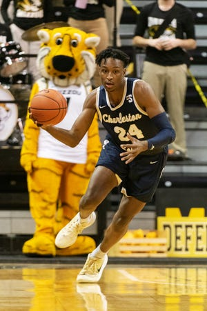 Charleston Southern's Phlandrous Fleming Jr. brings the ball up court during the first half of an NCAA college basketball game against Missouri Tuesday, Dec. 3, 2019, in Columbia, Mo. (AP Photo/L.G. Patterson)