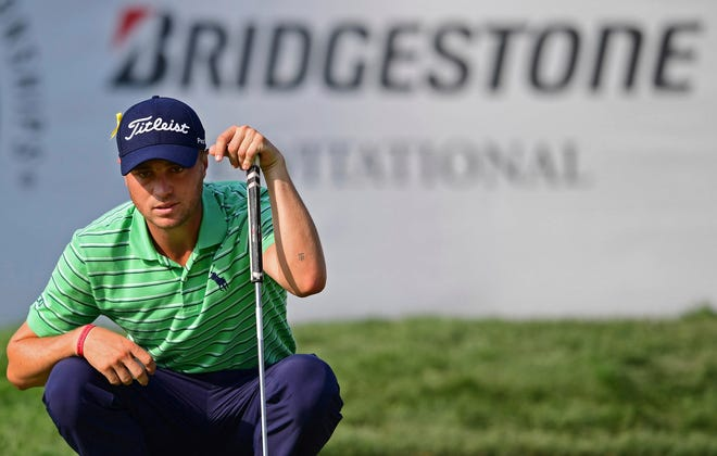 Justin Thomas reads the green on the 18th hole during the final round of the Bridgestone Invitational golf tournament at Firestone Country Club, Sunday, Aug. 5, 2018, in Akron, Ohio. (AP Photo/David Dermer)