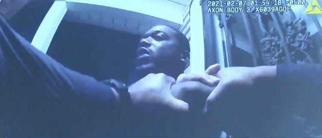 Akron police officers subdue Charles Hicks II on a domestic dispute call. Following an internal investigation, officer John Turnure resigned after it was discovered that he shoved snow into Hicks' open mouth, causing Hicks to struggle to breathe.