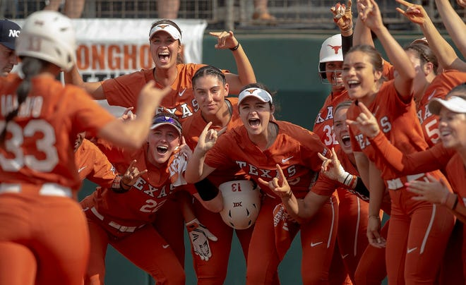Texas' Mary Iakopo, left, is greeted at home plate by teammates after hitting a home run in the 2019 Austin Regional. In the center of the cheering Longhorns is Shannon Rhodes. Iakopo and Rhodes are battling for UT's single-season home run record.