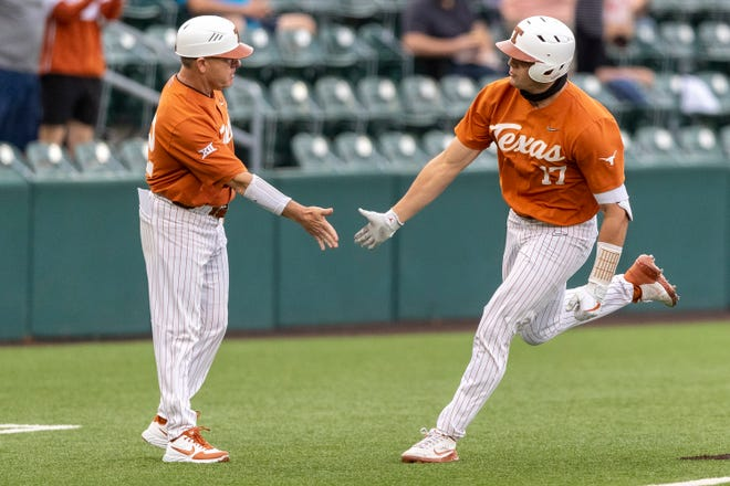 Texas designated hitter Ivan Melendez is congratulated on a two-run home run against Texas A&M-Corpus Christi on Tuesday by coach David Pierce. Melendez hit one out again Wednesday night; he has homered in three straight games.