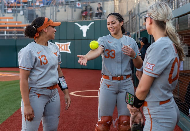Former Oregon softball players Shannon Rhodes (13), Mary Iakopo (33) and Lauren Burke are key players for coach Mike White at Texas.