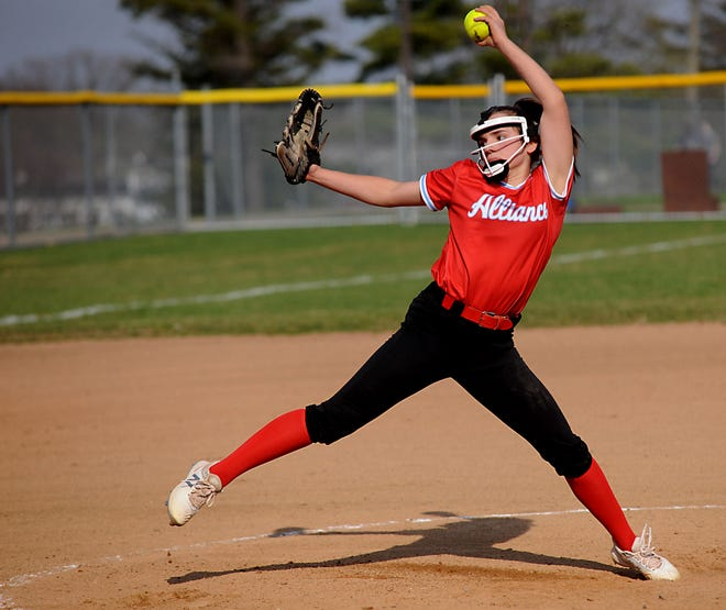 Alliance's Emma Reese winds up to throw a pitch in an Eastern Buckeye Conference game against Salem at Alliance High School Wednesday, April 7, 2021.