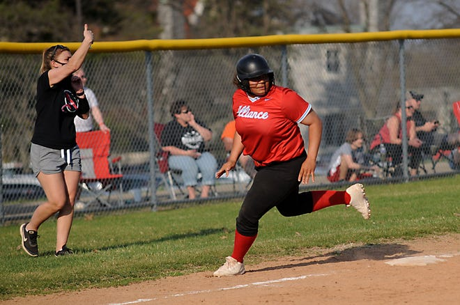 Alliance's Kylie Davis rounds third base in an Eastern Buckeye Conference game against Salem at Alliance High School Wednesday, April 7, 2021.