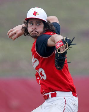 Loudonville's Bo Regan delivers a pitch against Fairless during the Redbirds' 6-2 win Thursday at Loudonville High School.