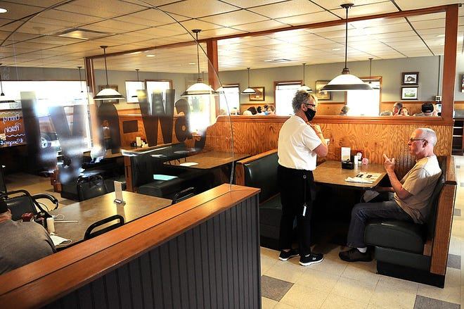 Lyn-Way Restaurant server Vicki Frost takes an order from a customer on Thursday. The eatery is celebrating seven decades in business this June.
