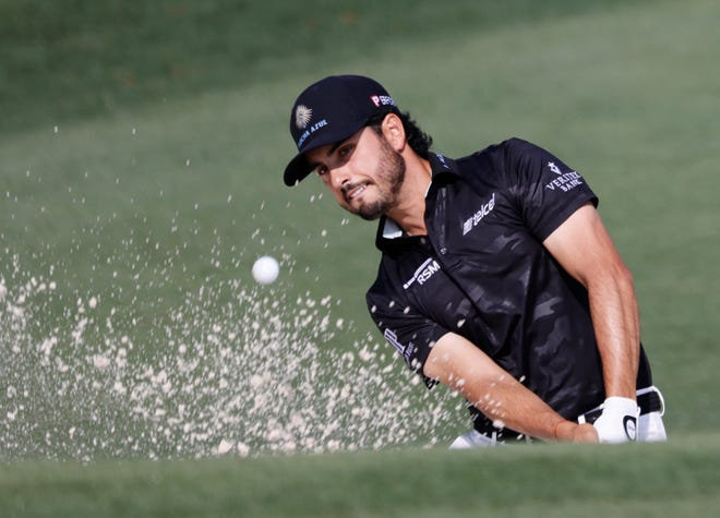 Abraham Ancer, hitting here from a bunker at the second hole of the Augusta National Golf Club, was penalized two strokes for a rule violation in a bunker at No. 15.